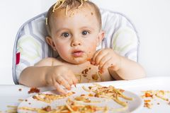 Little baby eating her dinner and making a mess Royalty Free Stock Photography
