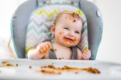 Little baby eating her dinner and making a mess Stock Photography