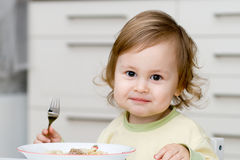 Little baby eating Stock Images