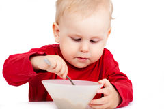 Little baby eating with spoon Royalty Free Stock Photos
