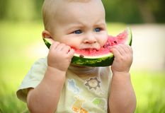 Little baby eating watermelon. Outdoors Royalty Free Stock Photos