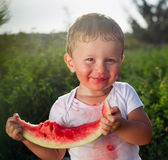 Little baby eating watermelon outdoors Royalty Free Stock Photography
