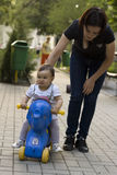 Little baby on a elephant bike Royalty Free Stock Photos