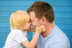 Little baby embrace his father. Family love concept stock photography