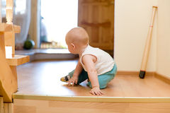 Little baby escaping from ungracious house Royalty Free Stock Photo