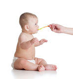 Little baby feeding with a spoon Stock Image