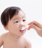 Little baby feeding with a spoon Royalty Free Stock Photography