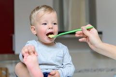 Little baby feeding Stock Photo