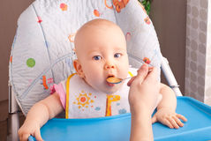 Little baby feeding with a spoon Stock Photo