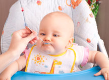 Little baby feeding with a spoon Stock Photography