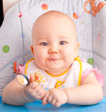 Little baby feeding with a spoon Royalty Free Stock Photo