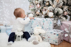 Little baby in a festive New Year`s interior Stock Photos
