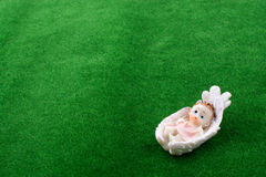 Little baby figure in  in a cradle Stock Images