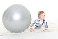 Little baby with fitness ball. Royalty Free Stock Images