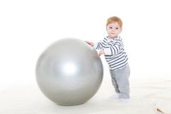 Little baby with fitness ball. Royalty Free Stock Photography