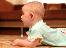 Surprised Baby on the Floor Royalty Free Stock Photo