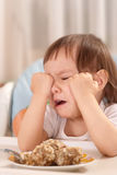 Little  baby with food and crying Stock Images
