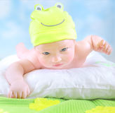 Little baby in frog costume Royalty Free Stock Image