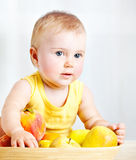 Little baby with fruits Royalty Free Stock Photography