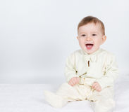 Little  baby funny boy in suit sitting. Stock Image