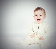 Little  baby funny boy in suit sitting. Royalty Free Stock Images
