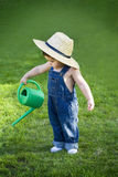 Little baby gardener lost in the moment Stock Images