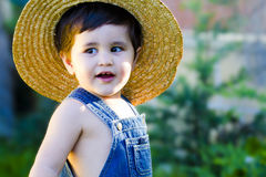 Little baby gardener smiling Royalty Free Stock Images