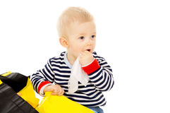 Little baby get wet wipes, and wipes his face Royalty Free Stock Photography