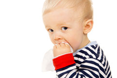 Little baby get wet wipes, and wipes his face Stock Photos