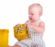 Little baby with a gift Stock Image
