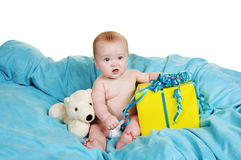 Little Baby with a Gift. Baby on a fluffy blue blanket with a big smile Stock Images