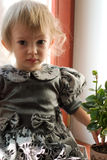Little baby girl. Little serious baby girl in formal dress, special contra-lightning Stock Image