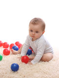 Little baby girl. Playing with balls Stock Image