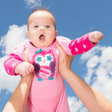 Little Baby Girl Against Cloudy Sky Stock Image