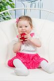 Little baby girl with apple Royalty Free Stock Image
