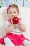 Little baby girl with apple Stock Image