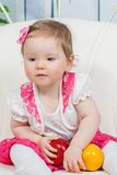 Little baby girl with apple and pear Royalty Free Stock Image