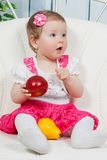 Little baby girl with apple and pear Royalty Free Stock Images