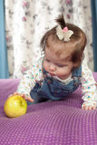 Little baby girl with an apple Royalty Free Stock Photos
