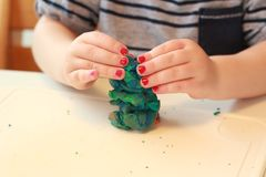 Free Little Baby Girl Are Playing With Play Dough. Mixes The Colors. Girl With Pink Polish. Play With Clay. Royalty Free Stock Image - 161580356