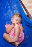 Little baby girl asleep outdoors. On a hammock at the sea beach Royalty Free Stock Photography