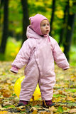 Little baby girl in autumn leaves Stock Photos