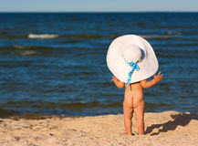 Little baby girl on the beach Stock Image