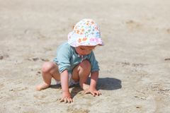 Baby girl beach stock images
