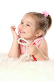 Little baby girl with beads dreaming Stock Image