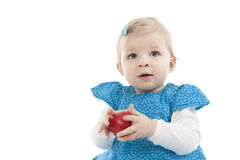 Little baby girl in blue dress with apple Royalty Free Stock Photos