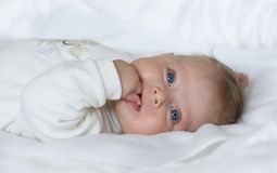 Little Baby Girl With Blue Eyes Royalty Free Stock Images