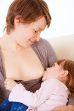 Little baby girl breast feeding. Stock Image
