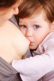Little baby girl breast feeding. Royalty Free Stock Images