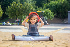 Little baby girl builder with the construction helmet and poster Stock Photo